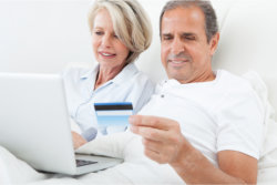 Old man holding a credit card