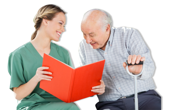 Old man looking at a book held by caregiver
