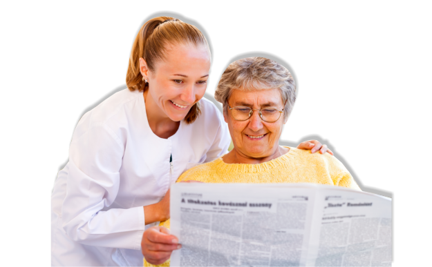 Old woman and caregiver reading a newspaper